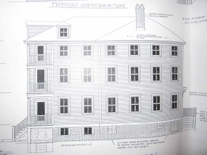 "The first plans called for massive expansion of the ""pink house"" (side view shown here at gateway to Pleasant Street and downtown Portsmouth)"