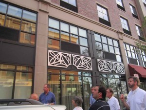 The city did not consult the City Council before assigning the HDC the task of deciding remedies to unauthorized changes to Portwalk III. Here, HDC chair Joseph Almeida and other view decorative aluminum trim