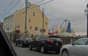 One of Portsmouth's vanishing unique views: This one along Market Street, unobstructed by the contested bumpout behind the former Carter's Antiques, shows a salt ship looking almost as if it were in the street...